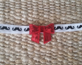 Black and white mustache headband with red sparkle bow