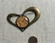 Needleminder - vintage clock design