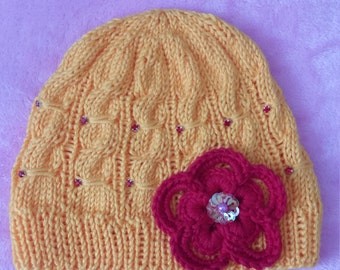 Yellow knitted baby girl hat