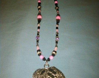 """Hot pink and black handmade crystal/glass beaded necklace with elephant """"good luck charm"""" pendant!"""