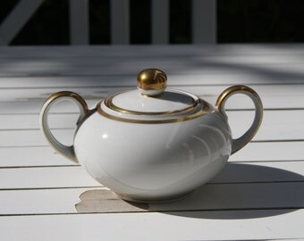 Vintage sugar bowl with gold accents
