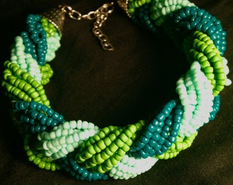 Twisted shades of green beaded lobster claw bracelet