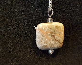Multi color agate on a silver chain.