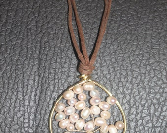 Necklace brown leather with a tree of life in natural pearls