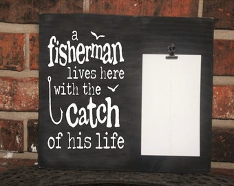 a fisherman lives here with the catch of his life  picture frame 4x6