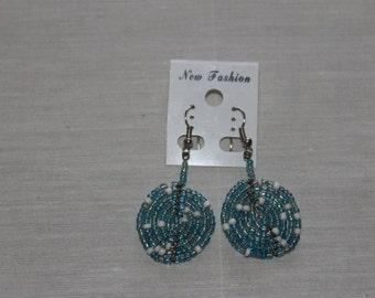 Metallic blue and white circular beaded earrings