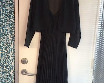 Elegant vintage black pleated evening dress