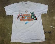 Vintage NIKE Charles Barkley vs Godzilla Footprint Battle of the Century Shirt Phoenix Suns Just Do It T Shirt 90s NBA Jordan Rare