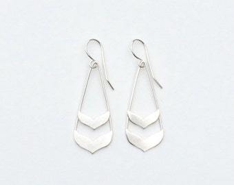 Small Double Whale Tail Earrings by Exquisite Machine