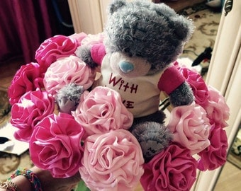delicate bouquet of satin roses with bear
