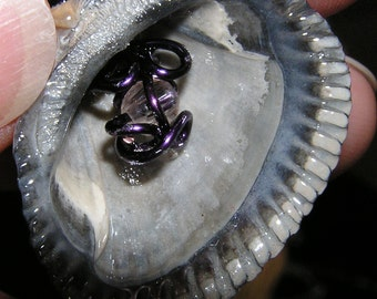 REDUCED-Sea shell pendant with purple wire and a shiny bead inside