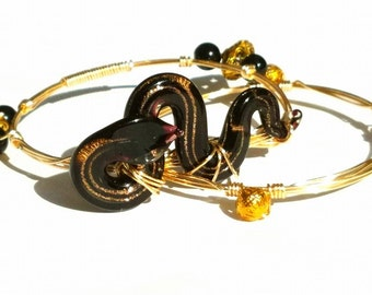 Black and Gold Snake on Gold Bangle with Gold and Black Accents