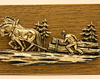 Retro wall plaque horses pulling timber with pine trees logging