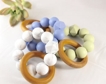 Silicone and wood teething rings