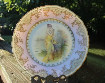 Collection Worthy Bavarian China Plate Featuring a Woman with Flower