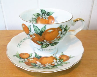 vintage orange California cup and saucer souvenir