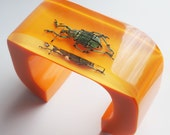 Fun cuff modern large orange bracelet with real beetle