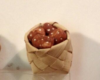 Miniature basket of potatoes