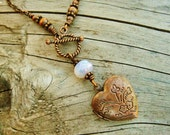 Locket necklace, Antiqued Copper with Czech Picasso opal glass bead - front close toggle clasp