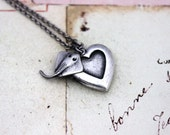 stingray. heart locket necklace. in silver ox jewelry