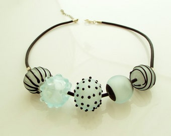 Glass lampwork necklace. icy shells blue glass five beads necklace