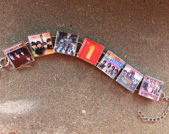 BEATLES record album cover bracelet. 50th anniversary can you believe it? Free USA shipping