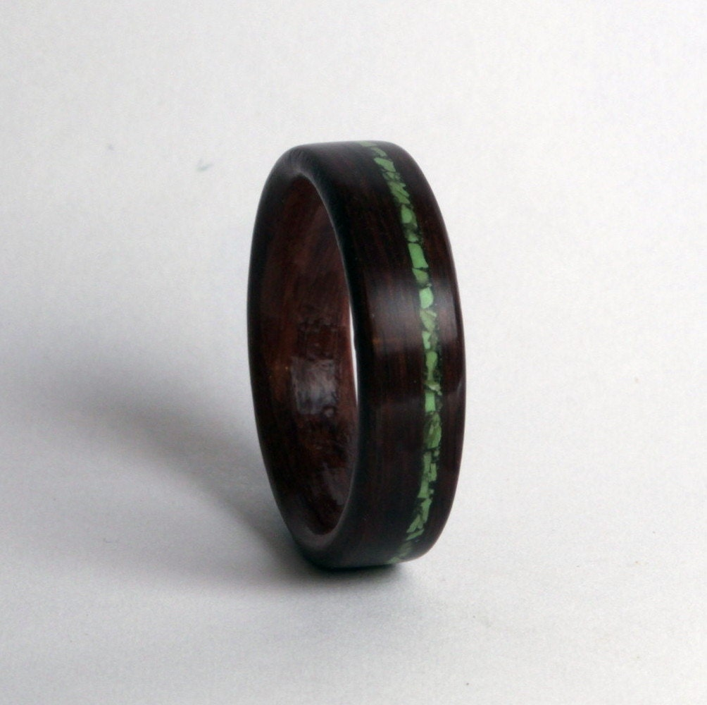leadwood ring with offset inlay of gaspeite wood
