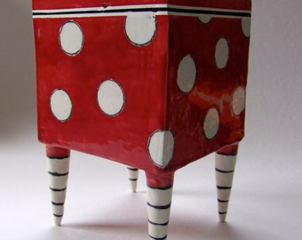 Big Red ceramic Planter with whimsical Black & White striped beetlejuice legs and polka-dots