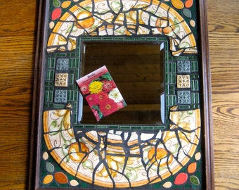 Mirror Recycle UpCycle Mosaic. Made from a broken Italian Charger with some Hand Made tiles, as well as corner leaves