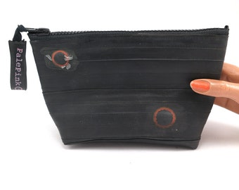 Recycled bicycle inner tube cosmetic pouch for men and woman, container, bag, with black zipper.