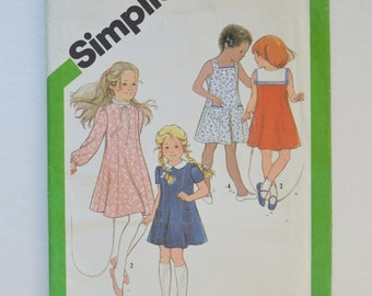 1980s Vintage Simplicity Sewing Pattern 9936 Girls Princess Seam Dress, Sleeveless, Short or Long Sleeves, High Neckline, Collars Size 4
