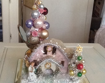 Pink Christmas Putz House with Bottlebrush tree on a mirrored compact