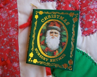 tiny green nursery rhymes book ornament