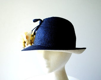 Summer fashion vintage 60s navy blue , cloche style straw hat with a bunch of the silk flowers. Made by Frank Olive for Emme Boutique.