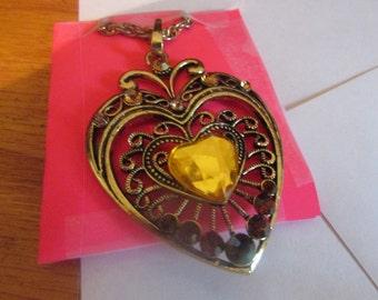Filigree brass heart