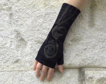 Black merino wool fingerless gloves, printed with fern koru design in dark gold, armwarmers, mittens.