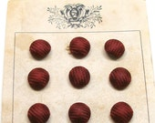 "1900s Silk BUTTONS, 12 Antique maroon silk braid, unused on original card, 3/8""."
