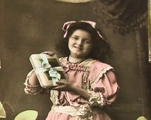 1920s French postcard, Girl with gift, RPPC paper ephemera. Real photo.