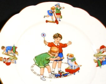 1930s childrens porcelain plate, Kids playing with toys & dog, Made in Germany.