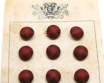 "1900s Silk BUTTONS, 12 Antique maroon silk braid, unused on original card, 3/8""."