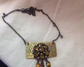 Etched metal and vintage rhinestone necklace