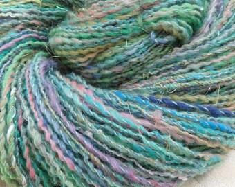 Breath of June handspun skein of sport weight merino, silk and eyelash yarn, 195 yards
