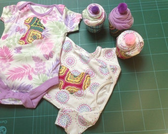 Lilac purple onesies bodysuit with Africa appliqué presented as a cupcake in gift box 0-3 months