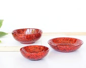 Trio set of three.One large,one medium and one small resin salt and pepper spice pinch trinket dish bowls in ruby red glitter sparkle.