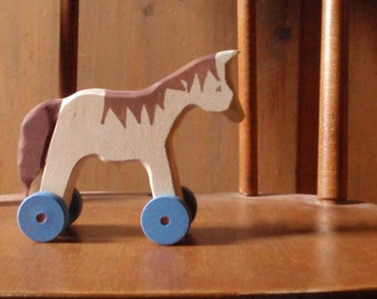 ginger-haired horse -push toy horse / classic wooden  folk toy