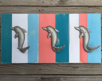 dolphin towel rack tropical tiki bar outdoor living space outside kitchen shower pool hot tub towels patio dolphin rescue Beach House Dreams