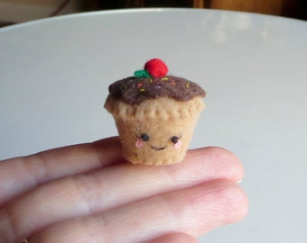 Cupcake miniature felt plush with smling face stuffed toy with chocolate frosting sprinkles and a cherry on top