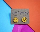 side-eye emoji earrings