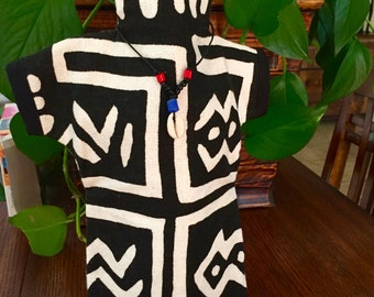 An African inspired black and white mud cloth design wine bottle cozy.