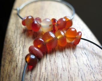 orange carnelian earrings. natural stone jewelry. hypoallergenic hoops.